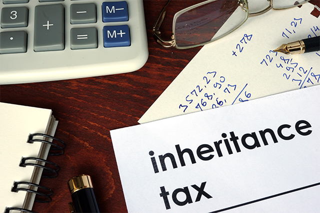 Inheritance tax written on a paper financial concept